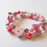 Children's bracelet with hearts and roses -