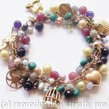 Wishes, Hopes - 9ct vintage gold charm bracelet with precious stones